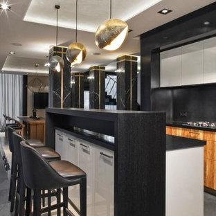 На фото: линейная кухня-гостиная в современном стиле с островом с