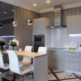 This is an example of a small contemporary single-wall open plan kitchen in Other with a drop-in sink, flat-panel cabinets, grey cabinets, laminate benchtops, white splashback, porcelain floors, a peninsula and stainless steel appliances.