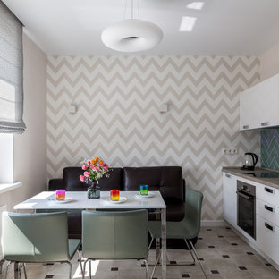 Inspiration for a mid-sized scandinavian single-wall eat-in kitchen in Moscow with a drop-in sink, flat-panel cabinets, white cabinets, laminate benchtops, green splashback, ceramic splashback, stainless steel appliances, ceramic floors, no island, beige floor and beige benchtop.