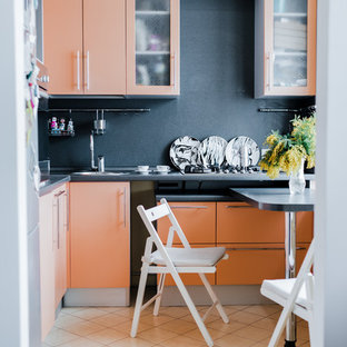 Photo of a small contemporary l-shaped eat-in kitchen in Moscow with flat-panel cabinets, orange cabinets, solid surface benchtops, grey splashback, ceramic floors, no island and beige floor.