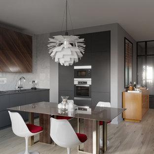 На фото: линейные кухни-гостиные в современном стиле с плоскими фасадами, серыми фасадами, светлым паркетным полом и бежевым полом без острова