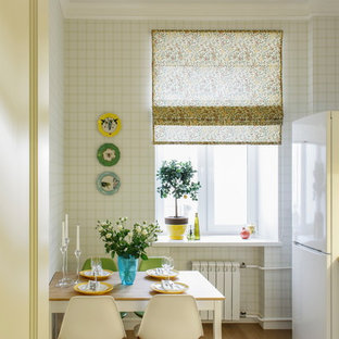 Design ideas for a small scandinavian single-wall separate kitchen in Moscow with no island and medium hardwood floors.