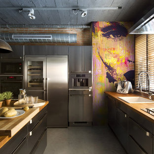 Inspiration for a mid-sized industrial galley eat-in kitchen in Moscow with a drop-in sink, wood benchtops, brown splashback, stainless steel appliances, multiple islands, grey floor and brown benchtop.