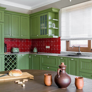 Traditional kitchen designs - Example of a classic l-shaped kitchen design in Other with a drop-in sink, recessed-panel cabinets, green cabinets and red backsplash