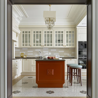 Inspiration for a large traditional l-shaped open plan kitchen in Moscow with beige cabinets, quartz benchtops, beige splashback, ceramic splashback, black appliances, porcelain floors, with island, beige floor and glass-front cabinets.