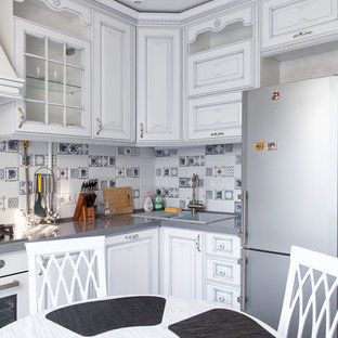 This is an example of a shabby-chic style separate kitchen in Moscow with a double-bowl sink, raised-panel cabinets, white cabinets, multi-coloured splashback, white appliances and no island.