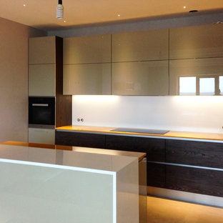 Design ideas for a large modern u-shaped eat-in kitchen in Other with a double-bowl sink, flat-panel cabinets, solid surface benchtops, white splashback, porcelain floors, with island, beige floor, beige cabinets, glass sheet splashback, black appliances and yellow benchtop.