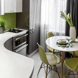 Inspiration for a small scandinavian l-shaped eat-in kitchen in Moscow with flat-panel cabinets, grey cabinets, solid surface benchtops, green splashback, mosaic tile splashback, stainless steel appliances, no island, an integrated sink and marble floors.