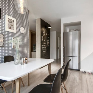 Mid-sized scandinavian eat-in kitchen inspiration - Mid-sized danish single-wall laminate floor eat-in kitchen photo in Saint Petersburg with a drop-in sink, flat-panel cabinets, white cabinets, wood countertops, ceramic backsplash, stainless steel appliances and no island