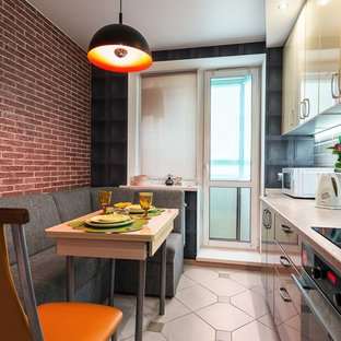 Inspiration for a small contemporary single-wall separate kitchen in Saint Petersburg with an undermount sink, flat-panel cabinets, beige cabinets, laminate benchtops, beige splashback, subway tile splashback, black appliances, ceramic floors, no island and beige floor.
