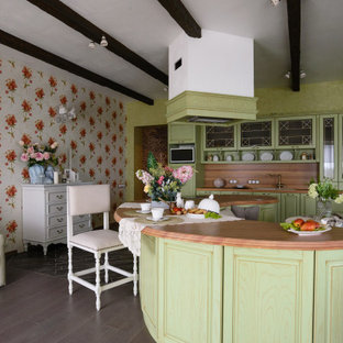 Inspiration for a mid-sized shabby-chic style l-shaped open plan kitchen in Novosibirsk with an undermount sink, raised-panel cabinets, green cabinets, wood benchtops, brown splashback, timber splashback, panelled appliances, with island, brown floor, brown benchtop and wallpaper.