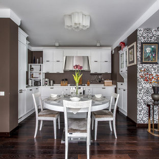 Design ideas for a large contemporary u-shaped eat-in kitchen in Other with white cabinets, solid surface benchtops, stainless steel appliances, dark hardwood floors, no island, brown splashback and recessed-panel cabinets.