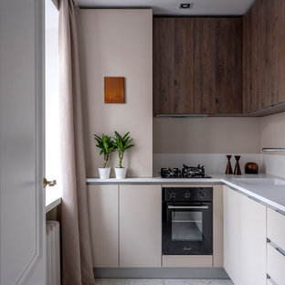 Inspiration for a contemporary l-shaped kitchen in Moscow with flat-panel cabinets, beige cabinets, beige splashback, black appliances, white benchtop, an integrated sink and white floor.