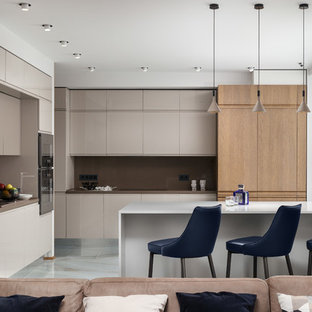 Contemporary open plan kitchen in Moscow with flat-panel cabinets, beige cabinets, brown splashback, a peninsula, white floor and brown benchtop.