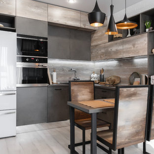Design ideas for a small industrial u-shaped separate kitchen in Moscow with an undermount sink, flat-panel cabinets, medium wood cabinets, wood benchtops, brown splashback, timber splashback, stainless steel appliances, ceramic floors, with island, grey floor and brown benchtop.