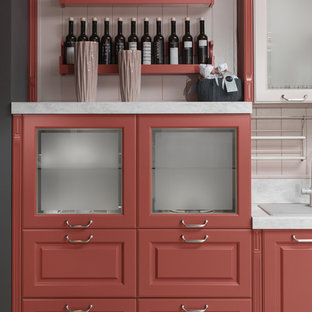 Design ideas for a contemporary kitchen in Other with raised-panel cabinets and red cabinets.