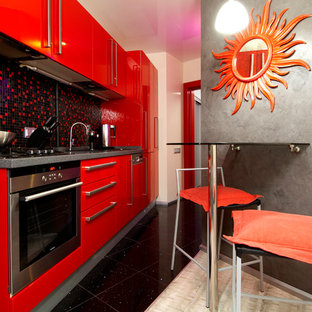 This is an example of a small contemporary single-wall separate kitchen in Moscow with an undermount sink, flat-panel cabinets, red cabinets, solid surface benchtops, black splashback, mosaic tile splashback, no island and stainless steel appliances.