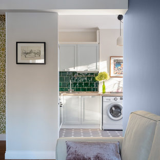 Inspiration for a small midcentury l-shaped eat-in kitchen in Moscow with a single-bowl sink, recessed-panel cabinets, grey cabinets, quartz benchtops, green splashback, ceramic splashback, porcelain floors, no island, grey floor and beige benchtop.