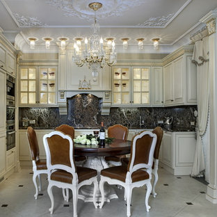 Inspiration for a traditional u-shaped kitchen in Saint Petersburg with raised-panel cabinets, white cabinets, black splashback, stainless steel appliances and no island.