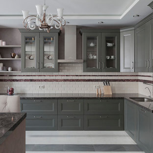 Design ideas for a mid-sized transitional l-shaped open plan kitchen in Moscow with an undermount sink, recessed-panel cabinets, green cabinets, quartz benchtops, beige splashback, subway tile splashback, black appliances, porcelain floors, grey benchtop and grey floor.
