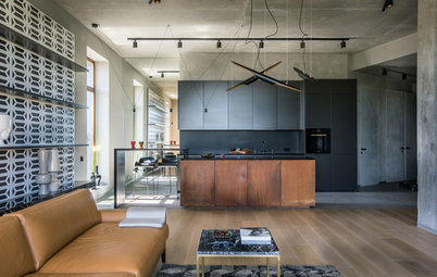Concrete, Metal & Leather Accent This Flat's Industrial Bones