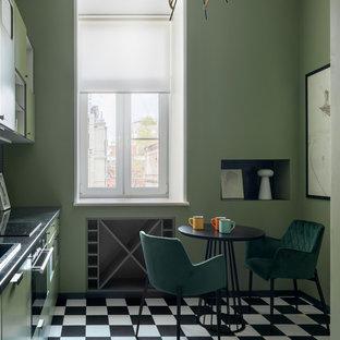 Diseño de cocina lineal, ecléctica, pequeña, cerrada, sin isla, con armarios con paneles lisos, puertas de armario verdes, encimera de granito, suelo de baldosas de porcelana, encimeras negras, suelo multicolor, fregadero encastrado y electrodomésticos negros