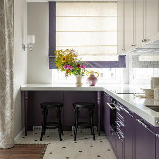 Inspiration for a small transitional l-shaped kitchen in Yekaterinburg with an undermount sink, flat-panel cabinets, purple cabinets, a peninsula, beige floor and white benchtop.