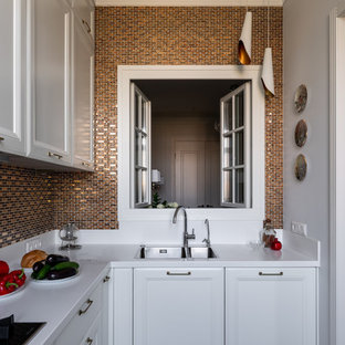 Inspiration for a mid-sized transitional l-shaped separate kitchen in Moscow with an undermount sink, raised-panel cabinets, white cabinets, solid surface benchtops, yellow splashback, mosaic tile splashback, stainless steel appliances, laminate floors, beige floor and white benchtop.