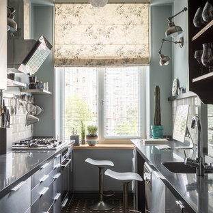 Inspiration for a midcentury galley kitchen in Moscow with an integrated sink, flat-panel cabinets, solid surface benchtops and ceramic splashback.