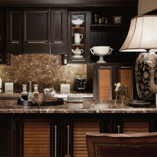 This is an example of a traditional galley separate kitchen in Moscow with louvered cabinets, black cabinets, brown splashback, with island, panelled appliances, beige floor and marble splashback.