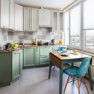 Photo of a small transitional l-shaped eat-in kitchen in Moscow with a drop-in sink, recessed-panel cabinets, green cabinets, grey splashback, no island and grey floor.