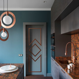 This is an example of a contemporary kitchen in Moscow with an undermount sink and orange benchtop.