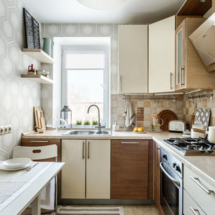 Contemporary l-shaped separate kitchen in Other with a drop-in sink, flat-panel cabinets, beige cabinets, beige splashback, black appliances, no island, beige floor and beige benchtop.