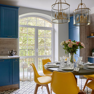 Transitional l-shaped eat-in kitchen in Other with shaker cabinets, blue cabinets, beige splashback, white appliances, no island and multi-coloured floor.