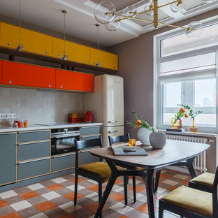 This is an example of a midcentury single-wall eat-in kitchen in Other with grey splashback, multi-coloured floor, flat-panel cabinets, grey cabinets, coloured appliances and grey benchtop.