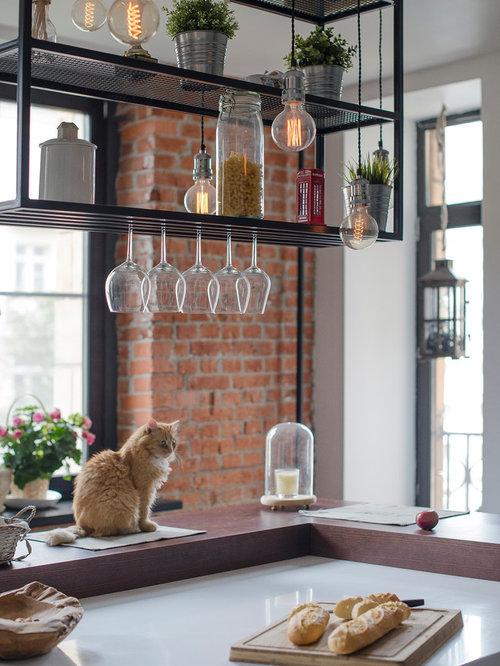 Küche mit flächenbündigen Schrankfronten und Vinylboden - Ideen & Bilder