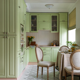 This is an example of a traditional l-shaped open plan kitchen in Moscow with a drop-in sink, raised-panel cabinets, green cabinets, white splashback, white appliances, no island, beige benchtop and multi-coloured floor.
