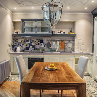 Photo of a mid-sized eclectic u-shaped eat-in kitchen in Saint Petersburg with solid surface benchtops, multi-coloured splashback, ceramic splashback, no island, multi-coloured floor and grey benchtop.