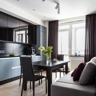 Design ideas for a contemporary single-wall eat-in kitchen in Saint Petersburg with flat-panel cabinets, solid surface benchtops, black splashback, porcelain floors, beige floor, black benchtop and black cabinets.