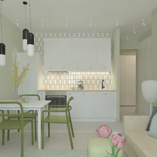 他の地域の小さいコンテンポラリースタイルのおしゃれなキッチン (シングルシンク、フラットパネル扉のキャビネット、白いキャビネット、ラミネートカウンター、ベージュキッチンパネル、セラミックタイルのキッチンパネル、磁器タイルの床、アイランドなし、グレーの床、ベージュのキッチンカウンター) の写真
