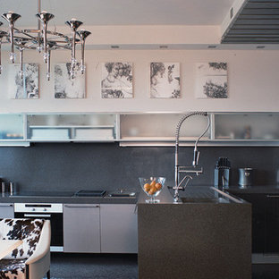 Design ideas for a small contemporary single-wall open plan kitchen in Moscow with an undermount sink, glass-front cabinets, white cabinets, solid surface benchtops, grey splashback, porcelain splashback, stainless steel appliances, carpet and a peninsula.