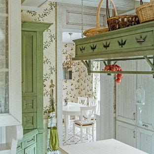 На фото: кухня в стиле кантри с белыми фасадами, столешницей из акрилового камня, полом из керамогранита и островом с