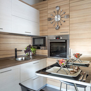 Inspiration for a small contemporary l-shaped separate kitchen in Moscow with a drop-in sink, laminate benchtops, stainless steel appliances, porcelain floors, flat-panel cabinets, white cabinets, brown splashback and no island.