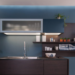Inspiration for a contemporary galley open plan kitchen in Moscow with an undermount sink, flat-panel cabinets, dark wood cabinets, quartz benchtops, blue splashback, stainless steel appliances, carpet and multiple islands.