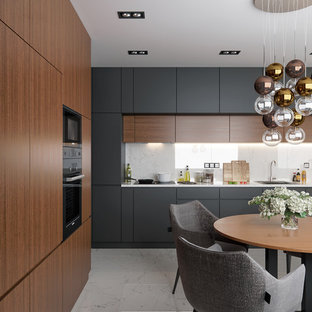 Design ideas for a mid-sized contemporary eat-in kitchen in Valencia with flat-panel cabinets, marble splashback, marble floors, white floor, a single-bowl sink, medium wood cabinets, white splashback and white benchtop.