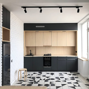 Inspiration for a mid-sized contemporary single-wall open plan kitchen in Other with flat-panel cabinets, grey cabinets, laminate benchtops, beige splashback, timber splashback, black appliances, porcelain floors, beige benchtop, a drop-in sink, no island and white floor.