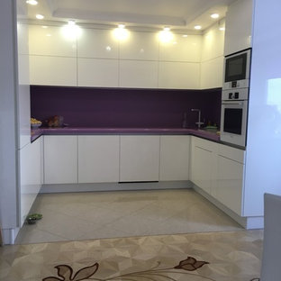 Inspiration for a large contemporary u-shaped eat-in kitchen in Moscow with an undermount sink, flat-panel cabinets, white cabinets, solid surface benchtops, white splashback, white appliances, medium hardwood floors, beige floor and purple benchtop.
