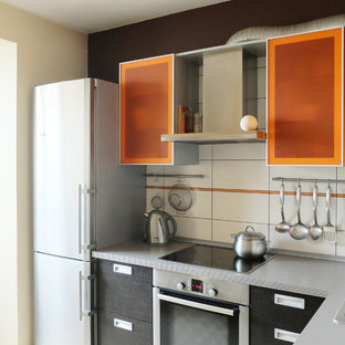 Photo of a small contemporary l-shaped eat-in kitchen in Moscow with flat-panel cabinets, orange cabinets, laminate benchtops, white splashback, ceramic splashback, stainless steel appliances, ceramic floors and no island.