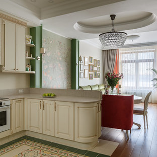 Design ideas for a transitional open plan kitchen in Saint Petersburg with raised-panel cabinets, beige cabinets, beige splashback, white appliances, a peninsula, multi-coloured floor and beige benchtop.