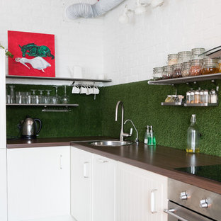 Inspiration for a scandinavian l-shaped kitchen in Moscow with a drop-in sink, white cabinets, green splashback, stainless steel appliances and no island.